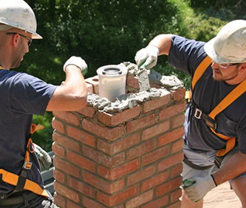 Chimney Workers On Roof