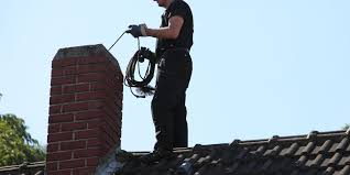 Chimney Worker On Roof