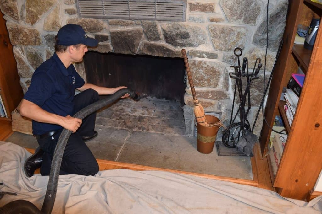 Chimney Worker Cleaning the fireplace
