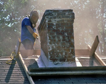 Chimney Worker Cleaning Concrete On Roof